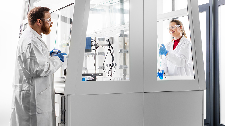 Two people working in a laboratory